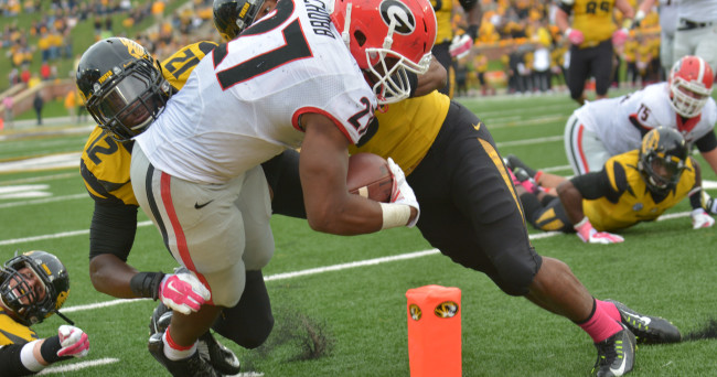 Oct 11, 2014; Columbia, MO, USA; Georgia Bulldogs running back Nick Chubb (27) scores a touchdown as Missouri Tigers linebacker Darvin Ruise (12) and safety Braylon Webb (9) make the tackle during the second half at Faurot Field. Georgia won 34-0. Mandatory Credit: Denny Medley-USA TODAY Sports