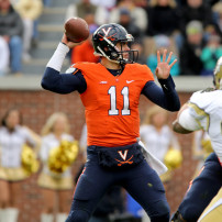 Nov 1, 2014; Atlanta, GA, USA; Virginia Cavaliers quarterback Greyson Lambert (11) attempts a pass as Georgia Tech Yellow Jackets defensive lineman Adam Gotsis (96) applies pressure in the first quarter of their game at Bobby Dodd Stadium. Mandatory Credit: Jason Getz-USA TODAY Sports