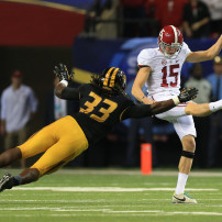 Dec 6, 2014; Atlanta, GA, USA; Alabama Crimson Tide punter JK Scott (15) is defended by Missouri Tigers defensive lineman Markus Golden (33) during the third quarter of the 2014 SEC Championship Game at the Georgia Dome. Mandatory Credit: Kevin Liles-USA TODAY Sports