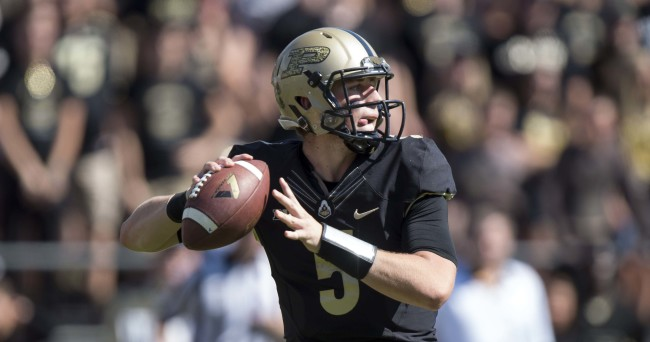 Sep 27, 2014; West Lafayette, IN, USA;  Purdue Boilermakers quarterback Danny Etling (5) looks to pass the ball during the second half of the game against the Iowa Hawkeyes at Ross Ade Stadium.  Mandatory Credit: Marc Lebryk-USA TODAY Sports