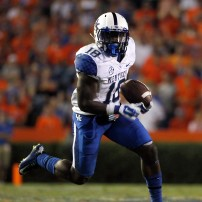 Sep 13, 2014; Gainesville, FL, USA; Kentucky Wildcats running back Stanley Williams (18) runs the ball in for a touchdown during the first overtime against the Florida Gators at Ben Hill Griffin Stadium. Florida Gators defeated the Kentucky Wildcats 36-30. Mandatory Credit: Kim Klement-USA TODAY Sports