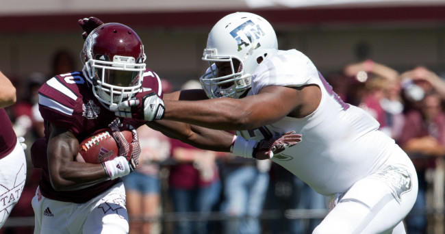 Oct 4, 2014; Starkville, MS, USA; Mississippi State Bulldogs running back Brandon Holloway (10) is tackled by Texas A&M Aggies defensive back Howard Matthews (31) at Davis Wade Stadium. Mandatory Credit: Marvin Gentry-USA TODAY Sports