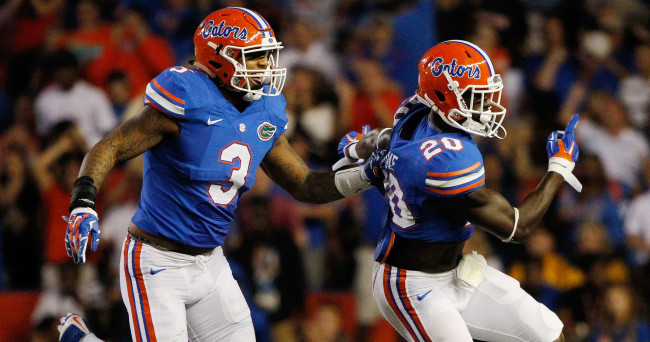 Oct 18, 2014; Gainesville, FL, USA; Florida Gators defensive back Marcus Maye (20) is congratulated by linebacker Antonio Morrison (3) after an interception against the Missouri Tigers during the first quarter at Ben Hill Griffin Stadium. Mandatory Credit: Kim Klement-USA TODAY Sports