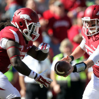 Oct 25, 2014; Fayetteville, AR, USA; Arkansas Razorbacks quarterback Brandon Allen (10) hands off to running back Alex Collins (3) in the game against the UAB Blazers at Donald W. Reynolds Razorback Stadium. Arkansas defeated UAB 45-17. Mandatory Credit: Nelson Chenault-USA TODAY Sports