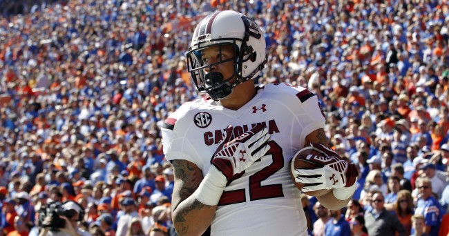 Nov 15, 2014; Gainesville, FL, USA; South Carolina Gamecocks running back Brandon Wilds (22) reacts after he scored a touchdown against the Florida Gators during the first quarter at Ben Hill Griffin Stadium. Mandatory Credit: Kim Klement-USA TODAY Sports