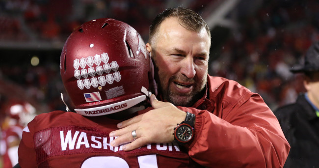 Nov 22, 2014; Fayetteville, AR, USA; Arkansas Razorbacks head coach Bret Bielema celebrates with cornerback Carroll Washington (21) after the game against the Ole Miss Rebels at Donald W. Reynolds Razorback Stadium. Arkansas defeated Mississippi 30-0. Mandatory Credit: Nelson Chenault-USA TODAY Sports