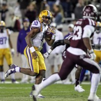 Nov 27, 2014; College Station, TX, USA; LSU Tigers quarterback Anthony Jennings (10) runs with the ball during the second quarter against the Texas A&M Aggies at Kyle Field. Mandatory Credit: Troy Taormina-USA TODAY Sports