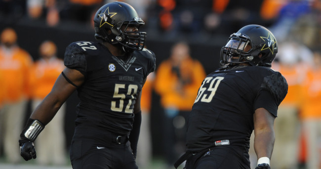 Nov 29, 2014; Nashville, TN, USA; Vanderbilt Commodores defensive lineman Adam Butler (69) and linebacker Nigel Bowden (52) celebrate after sacking Tennessee Volunteers quarterback Josh Dobbs (11) during the first half at Vanderbilt Stadium. Mandatory Credit: Christopher Hanewinckel-USA TODAY Sports