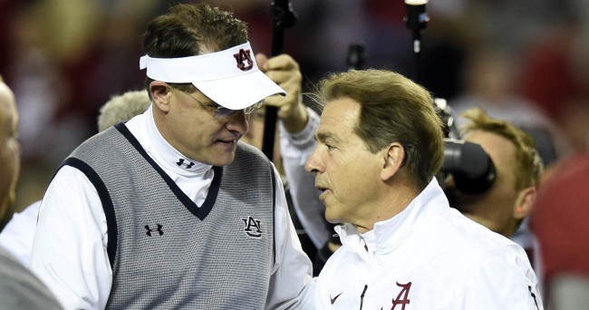 Nov 29, 2014; Tuscaloosa, AL, USA; Auburn Tigers head coach Gus Malzahn (left) and Alabama Crimson Tide head coach Nick Saban greet one another prior to the game at Bryant-Denny Stadium. Mandatory Credit: John David Mercer-USA TODAY Sports