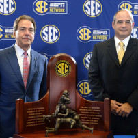 Dec 5, 2014; Atlanta, GA, USA; Alabama Crimson Tide head coach Nick Saban and Missouri Tigers head coach Gary Pinkel pose for photos with the Southeastern Conference trophy during a press conference at the Georgia Dome. Missouri plays the Alabama Crimson Tide in the SEC Championship Saturday. Mandatory Credit: John David Mercer-USA TODAY Sports