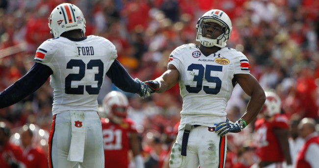 Jan 1, 2015; Tampa, FL, USA; Auburn Tigers defensive back Joe Turner (35) and defensive back Johnathan Ford (23) high five during the second half in the 2015 Outback Bowl against the Wisconsin Badgers at Raymond James Stadium. Wisconsin Badgers defeated the Auburn Tigers 34-31 in overtime. Mandatory Credit: Kim Klement-USA TODAY Sports