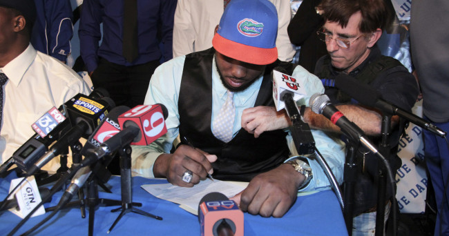 Feb 4, 2015; Apopka, FL, USA; Martez Ivey signs his letter of intent that he has chosen to play football for the University of Florida during a press conference at Apopka High School. Mandatory Credit: Reinhold Matay-USA TODAY Sports