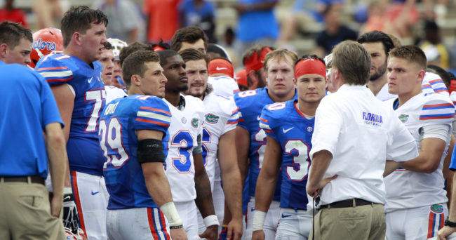 Apr 11, 2015; Gainesville, FL, USA; Florida Gators head coach Jim McElwain huddles up with his team at the end of the Orange and Blue Debut at Ben Hill Griffin Stadium. Orange defeated Blue 31-6. Mandatory Credit: Kim Klement-USA TODAY Sports