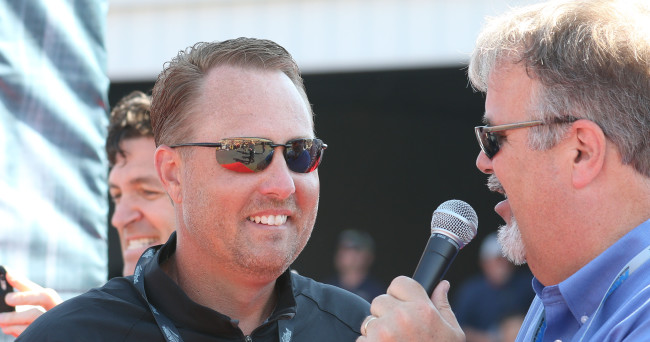 May 3, 2015; Talladega, AL, USA; Ole Miss head coach Hugh Freeze (L) smiles outside the NASCAR Sprint Cup drivers meeting prior to the GEICO 500 at Talladega Superspeedway. Mandatory Credit: Marvin Gentry-USA TODAY Sports
