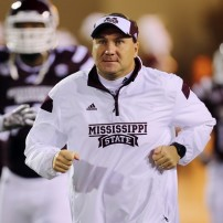 Nov 22, 2014; Starkville, MS, USA; Mississippi State Bulldogs head coach Dan Mullen runs onto the field before the game between the Mississippi State Bulldogs and the Vanderbilt Commodores at Davis Wade Stadium. Mandatory Credit: Spruce Derden-USA TODAY Sports