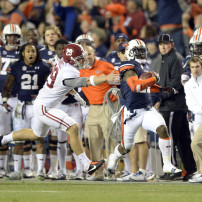 Nov 30, 2013; Auburn, AL, USA; Auburn Tigers cornerback Chris Davis (11) gets past Alabama Crimson Tide punter Cody Mandell (29) and scores a 100 yard touchdown during the fourth quarter at Jordan Hare Stadium. Auburn Tigers won 34-28. Mandatory Credit: John David Mercer-USA TODAY Sports