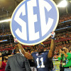 Dec 7, 2013; Atlanta, GA, USA; Auburn Tigers cornerback Chris Davis (11) holds up the SEC sign after the 2013 SEC Championship game against the Missouri Tigers at Georgia Dome. The Auburn Tigers defeated the Missouri Tigers 59-42. Mandatory Credit: Kevin Liles-USA TODAY Sports
