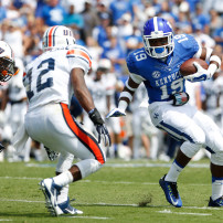 Aug 30, 2014; Lexington, KY, USA; Kentucky Wildcats wide receiver Garrett Johnson (19) runs the ball against UT Martin Skyhawks safety Taino Fears-Perez (12) in the second half at Commonwealth Stadium. Kentucky defeated UT Martin 59-14. Mandatory Credit: Mark Zerof-USA TODAY Sports