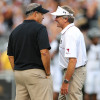 Sep 27, 2014; Columbia, SC, USA;  South Carolina Gamecocks head coach Steve Spurrier and Missouri Tigers head coach Gary Pinkel enjoy a conversation mid field during pre-game warm ups at Williams-Brice Stadium. Missouri wins in the final minutes 21-20 over South Carolina. Mandatory Credit: Jim Dedmon-USA TODAY Sports