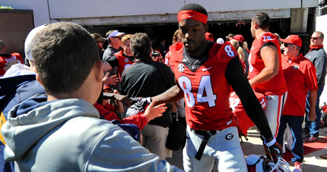 Oct 4, 2014; Athens, GA, USA; Georgia Bulldogs linebacker Leonard Floyd (84) greets fans on his way into the stadium prior to the game against the Vanderbilt Commodores at Sanford Stadium. Mandatory Credit: Dale Zanine-USA TODAY Sports