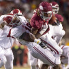 Oct 11, 2014; Fayetteville, AR, USA; Alabama Crimson Tide linebacker Reggie Ragland (19) tackles Arkansas Razorbacks wide receiver Eric Hawkins (14) during the second half of a game at Donald W. Reynolds Razorback Stadium. Alabama defeated Arkansas 14-13. Mandatory Credit: Beth Hall-USA TODAY Sports