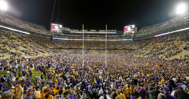 Oct 25, 2014; Baton Rouge, LA, USA; LSU Tigers fans storm the field following the Tigers 10-7 victory agains the Mississippi Rebels at Tiger Stadium. Mandatory Credit: Crystal LoGiudice-USA TODAY Sports