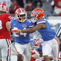 Nov 1, 2014; Jacksonville, FL, USA; Florida Gators defensive back Brian Poole (24) is congratulated by defensive back Vernon Hargreaves III (1) after forcing a fumble against the Georgia Bulldogs during the second half at EverBank Field. Florida Gators defeated the Georgia Bulldogs 38-20. Mandatory Credit: Kim Klement-USA TODAY Sports