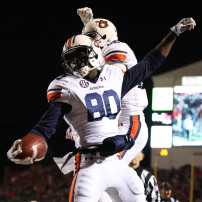 Nov 1, 2014; Oxford, MS, USA; Auburn Tigers wide receiver Marcus Davis (80) celebrates with wide receiver Melvin Ray (82) after scoring a touchdown against the Ole Miss Rebels at Vaught-Hemingway Stadium. Auburn defeated Ole Miss 35-31. Mandatory Credit: Nelson Chenault-USA TODAY Sports