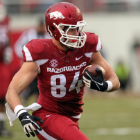 Nov 22, 2014; Fayetteville, AR, USA; Arkansas Razorbacks tight end Hunter Henry (84) runs after a catch in the first half against the Ole Miss Rebels at Donald W. Reynolds Razorback Stadium. Mandatory Credit: Nelson Chenault-USA TODAY Sports