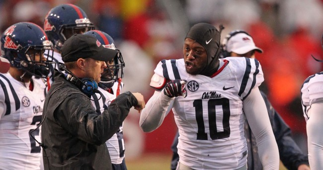 Nov 22, 2014; Fayetteville, AR, USA; Ole Miss Rebels head coach Hugh Freeze talks to defensive end C.J. Johnson (10) during a timeout in the game against the Arkansas Razorbacks at Donald W. Reynolds Razorback Stadium. Arkansas defeated Mississippi 30-0. Mandatory Credit: Nelson Chenault-USA TODAY Sports