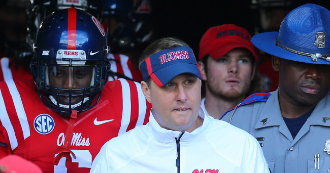 Nov 29, 2014; Oxford, MS, USA; Mississippi Rebels head coach Hugh Freeze leads the team onto the field before the game against the Mississippi State Bulldogs at Vaught-Hemingway Stadium. Mandatory Credit: Spruce Derden-USA TODAY Sports