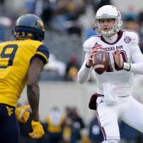 Dec 29, 2014; Memphis, TN, USA; Texas A&M Aggies quarterback Kyle Allen (10) looks to pass defended by West Virginia Mountaineers safety KJ Dillon (9) during the 2014 Liberty Bowl at Liberty Bowl Memorial Stadium. Texas A&M Aggies beat West Virginia Mountaineers 45 - 37. Mandatory Credit: Justin Ford-USA TODAY Sports