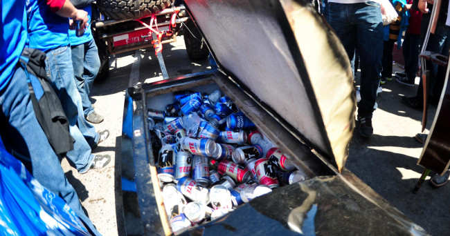 Jun 5, 2015; Ensenada, Baja California, Mexico; Racers fill a coffin with beer during technical inspection and contingency for the 47th SCORE Baja 500. Mandatory Credit: Matt Kartozian-USA TODAY Sports