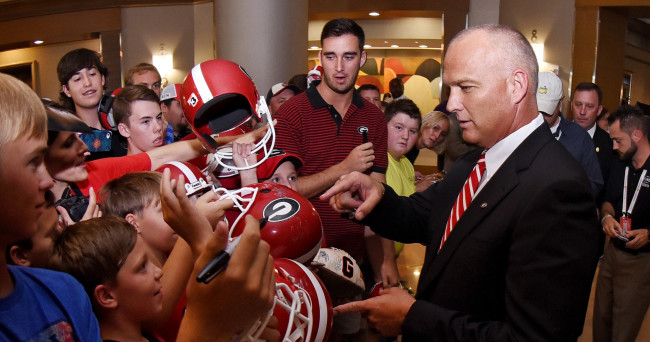 Jul 16, 2015; Hoover, AL, USA; Georgia Bulldogs coach Mark Richt interacts with fans after the SEC media days at the Wynfrey Hotel. Mandatory Credit: Kelly Lambert-USA TODAY Sports