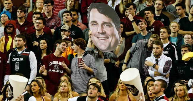 Jan 16, 2016; Columbia, SC, USA; South Carolina Gamecocks student section sporting a new fathead of new football coach Will Muschamp during the regular season game at Colonial Life Arena. Gamecocks win 81-72 over the Tigers. Mandatory Credit: Jim Dedmon-USA TODAY Sports