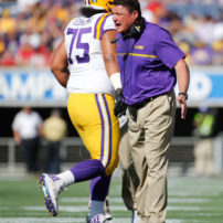 Dec 31, 2016; Orlando , FL, USA; LSU Tigers head coach Ed Orgeron congratulates guard Maea Teuhema (75) and teammates after they scored against the Louisville Cardinals during the second half at Camping World Stadium. LSU Tigers defeated the Louisville Cardinals 29-9. Mandatory Credit: Kim Klement-USA TODAY Sports