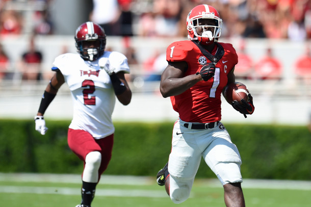 Sep 20, 2014; Athens, GA, USA; Georgia Bulldogs running back Sony Michel (1) runs down the field ahead of Troy Trojans cornerback Keion Payne (2) during the first quarter at Sanford Stadium. Mandatory Credit: Dale Zanine-USA TODAY Sports