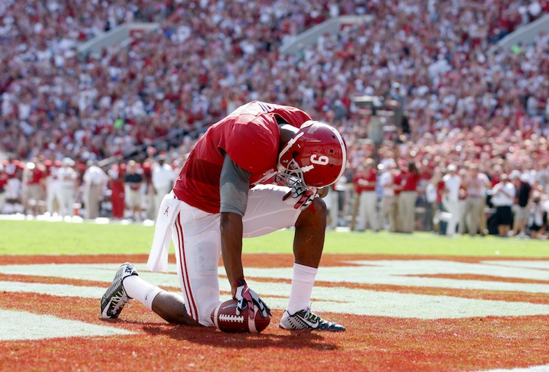 Sep 20, 2014; Tuscaloosa, AL, USA; Alabama Crimson Tide wide receiver Amari Cooper (9) takes a moment after caching a pass for a touchdown against the Florida Gators at Bryant-Denny Stadium. Mandatory Credit: Marvin Gentry-USA TODAY Sports