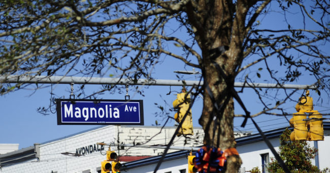 Feb 14, 2015; Auburn, AL, USA; A street sign as seen through the branches of a newly planted tree at Toomer's Corner. Mandatory Credit: Shanna Lockwood-USA TODAY Sports