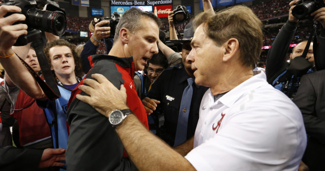Jan 1, 2015; New Orleans, LA, USA; Ohio State Buckeyes head coach Urban Meyer and Alabama Crimson Tide head coach Nick Saban greet each other after the 2015 Sugar Bowl at Mercedes-Benz Superdome. Ohio State defeated Alabama 42-35. Mandatory Credit:  Matthew Emmons-USA TODAY Sports