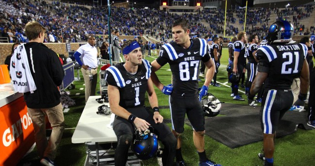 Oct 31, 2015; Durham, NC, USA; Duke Blue Devils quarterback Thomas Sirk (1) and wide receiver Max McCaffrey (87) watch the monitor as officials try to decide the end of the game Miami Hurricanes touchdown in the closing seconds of their game at Wallace Wade Stadium. Mandatory Credit: Mark Dolejs-USA TODAY Sports