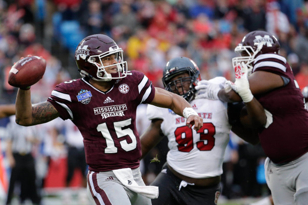 Dec 30, 2015; Charlotte, NC, USA; Mississippi State Bulldogs quarterback Dak Prescott (15) throws a pass during the first quarter against the North Carolina State Wolfpack in the 2015 Belk Bowl at Bank of America Stadium. Mandatory Credit: Jeremy Brevard-USA TODAY Sports