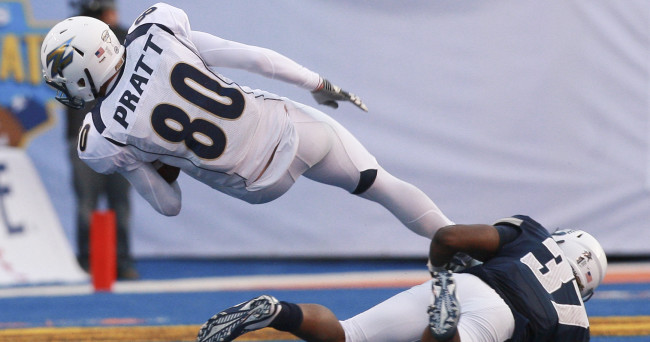 Dec 22, 2015; Boise, ID, USA; Akron Zips wide receiver Andrew Pratt (80) is tackled by Utah State Aggies safety Devin Centers (37) during second half action  in the 2015 Famous Idaho Potato Bowl at Bronco Stadium. Akron defeated Utah State 23-21.  Mandatory Credit: Brian Losness-USA TODAY Sports