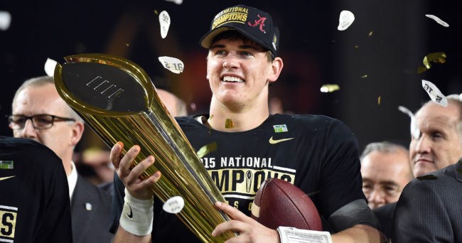Jan 11, 2016; Glendale, AZ, USA; Alabama Crimson Tide quarterback Jake Coker (14) celebrates with the 2016 CFP National Championship trophy after beating the Clemson Tigers at University of Phoenix Stadium. Mandatory Credit: Kirby Lee-USA TODAY Sports