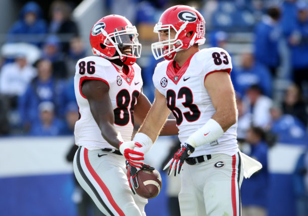 Nov 8, 2014; Lexington, KY, USA; Georgia Bulldogs split end Justin Scott-Wesley (86) celebrates with tight end Jeb Blazevich (83) after scoring a touchdown against the Kentucky Wildcats at Commonwealth Stadium. Georgia defeated Kentucky 63-31. Mandatory Credit: Mark Zerof-USA TODAY Sports