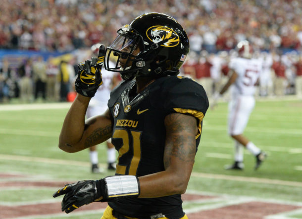 Dec 6, 2014; Atlanta, GA, USA; Missouri Tigers wide receiver Bud Sasser (21) motions after scoring on a touchdown pass against the Alabama Crimson Tide in the third quarter of the 2014 SEC Championship Game at the Georgia Dome. Mandatory Credit: John David Mercer-USA TODAY Sports