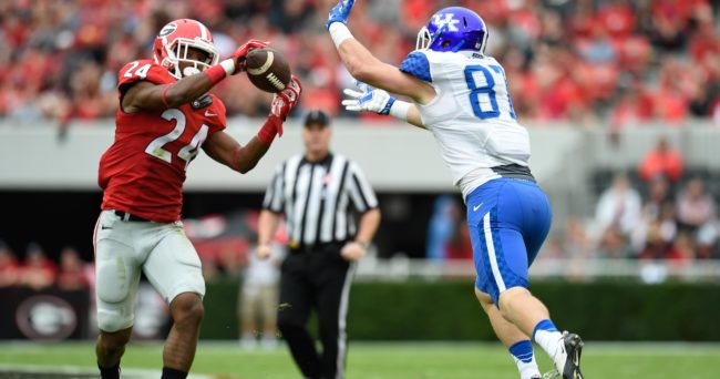 Nov 7, 2015; Athens, GA, USA; Georgia Bulldogs safety Dominick Sanders (24) intercepts the ball in front of Kentucky Wildcats tight end C.J. Conrad (87) during the first half at Sanford Stadium. Mandatory Credit: Dale Zanine-USA TODAY Sports