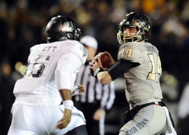 Nov 21, 2015; Nashville, TN, USA; Vanderbilt Commodores quarterback Kyle Shurmur (14) drops back to pass during the first half against the Texas A&M Aggies at Vanderbilt Stadium. Mandatory Credit: Christopher Hanewinckel-USA TODAY Sports