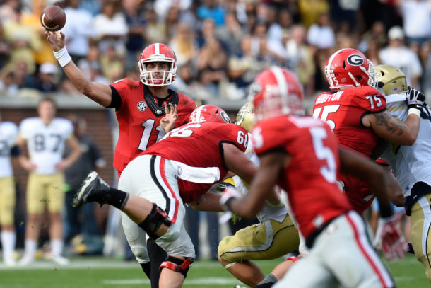 Nov 28, 2015; Atlanta, GA, USA; Georgia Bulldogs quarterback Greyson Lambert (11) passes to wide receiver Terry Godwin (5) during the game against the Georgia Tech Yellow Jackets during the second half at Bobby Dodd Stadium. Georgia defeated Georgia Tech 13-7. Mandatory Credit: Dale Zanine-USA TODAY Sports
