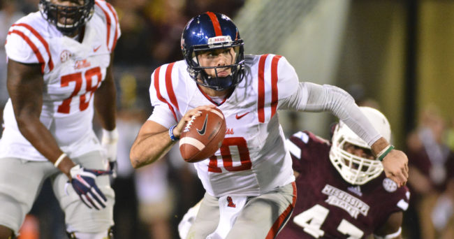 Nov 28, 2015; Starkville, MS, USA; Mississippi Rebels quarterback Chad Kelly (10) runs the ball during the second quarter of the game against the Mississippi State Bulldogs at Davis Wade Stadium. Mandatory Credit: Matt Bush-USA TODAY Sports